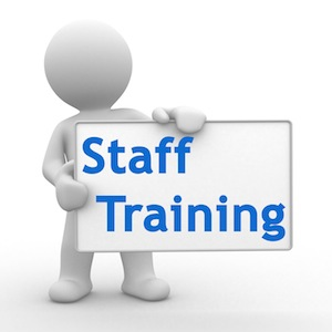 """Image of a stick figure holding a sign that reads """"Staff Training"""""""