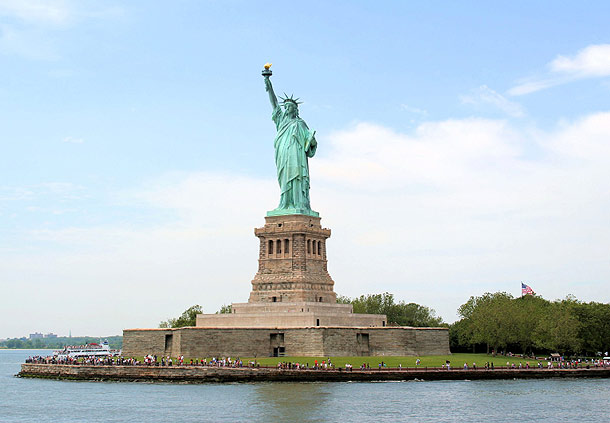 Photo of the statue of liberty and liberty island summer daytime.